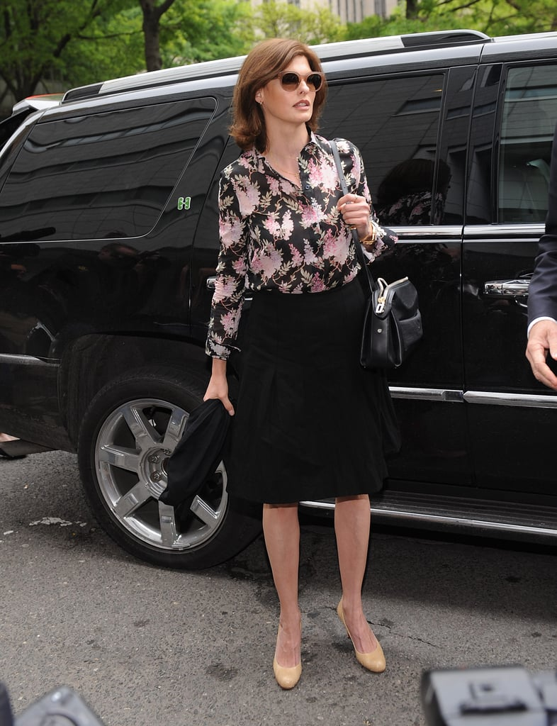On day one, Linda tucked a floral blouse into a pleated black knee-length skirt, then added much-needed funk via round shades and a cool black shoulder bag. Top this look off with a blazer to sharpen things up.  6848994