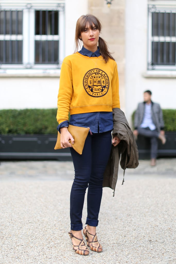 A pop of yellow on her cheeky sweatshirt lends a cool-girl dynamic to her denim on denim.