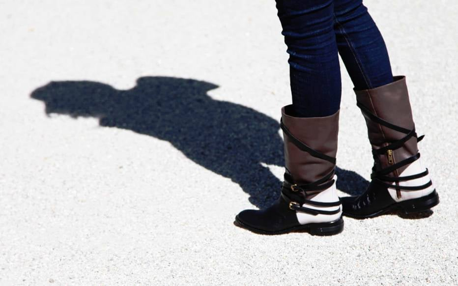 The contrast of a preppy riding boot against a multistrapped silhouette gives this particular style an edge we can't resist.
