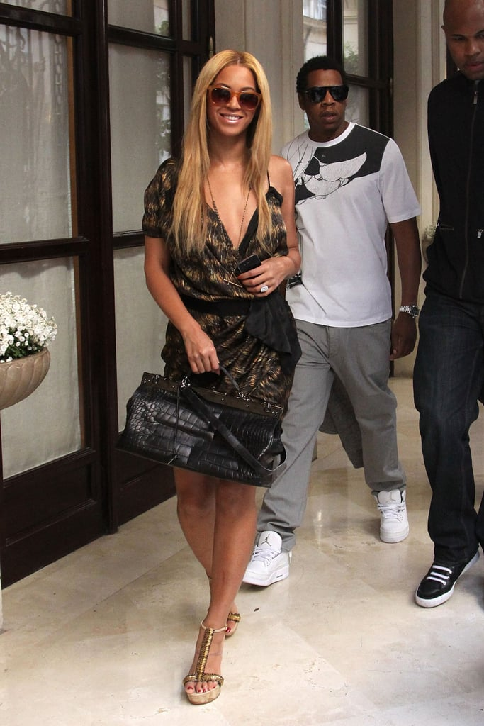 While vacationing in France in April 2011, Beyoncé donned a printed dress and Jay Z coordinated his white printed tee with his crisp white sneakers.