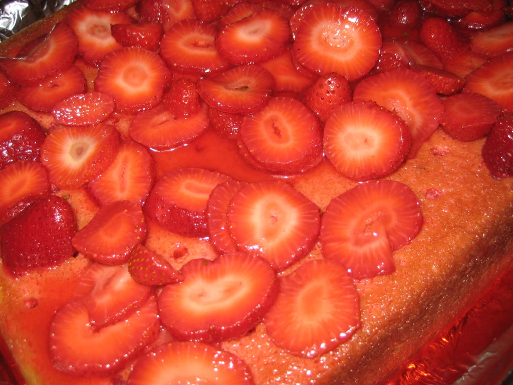Evenly spread the strawberries over the cake.