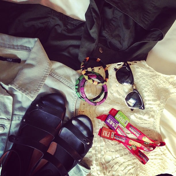 The minute we got to our hotel, we laid out our festival essentials. Our weekend wardrobe included an anorak (for the Friday rain forecast), a Tibi denim vest, comfy Madewell flat sandals, Ray-Bans, and a lot of arm candy, including our Lolla wristbands. Source: Instagram user POPSUGARFashion