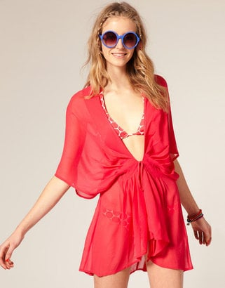 Easy slip-on in a vibrant coral hue.   ASOS Pleat Front Chiffon Cover Up, $55