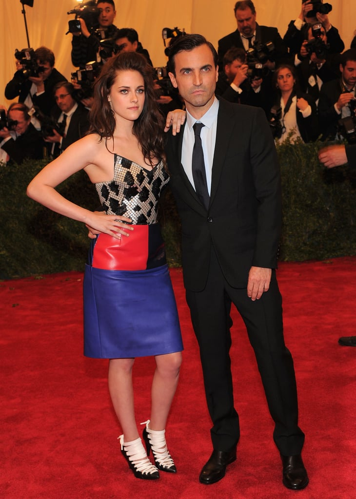 Kristen Stewart posed with her hand on her hip at the Met Gala with Balenciaga designer Nicolas Ghesquiere.