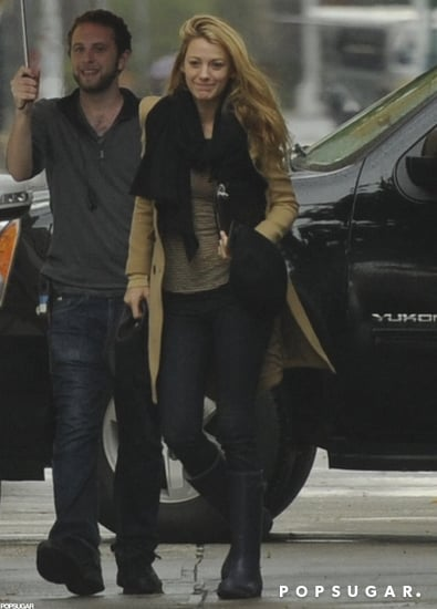Blake Lively arrived on set with a smile.