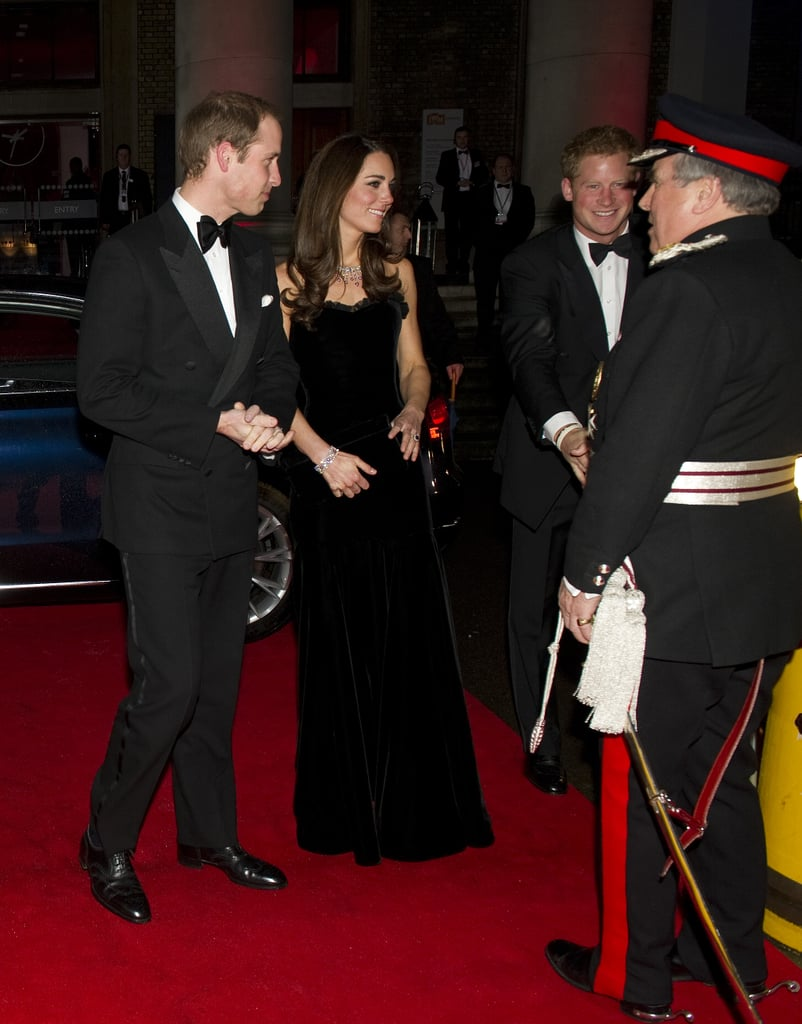 Prince Harry got a big smile out of Kate Middleton as they headed into a military awards ceremony with Prince William.