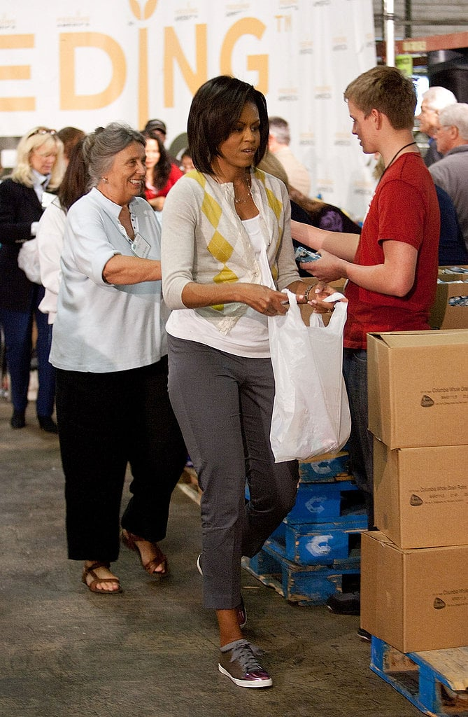 The FLOTUS sported J.Crew's signature argyle cardigan with cropped gray pants and snazzy Lanvin sneakers.