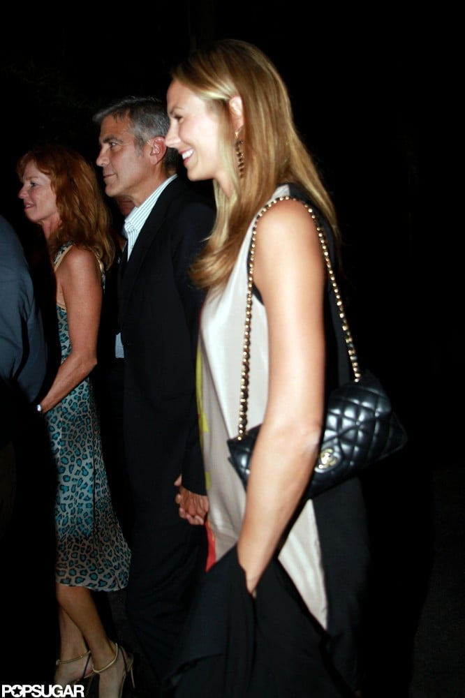 Stacy Keibler held hands with George Clooney while dining out in Lake Como in June.