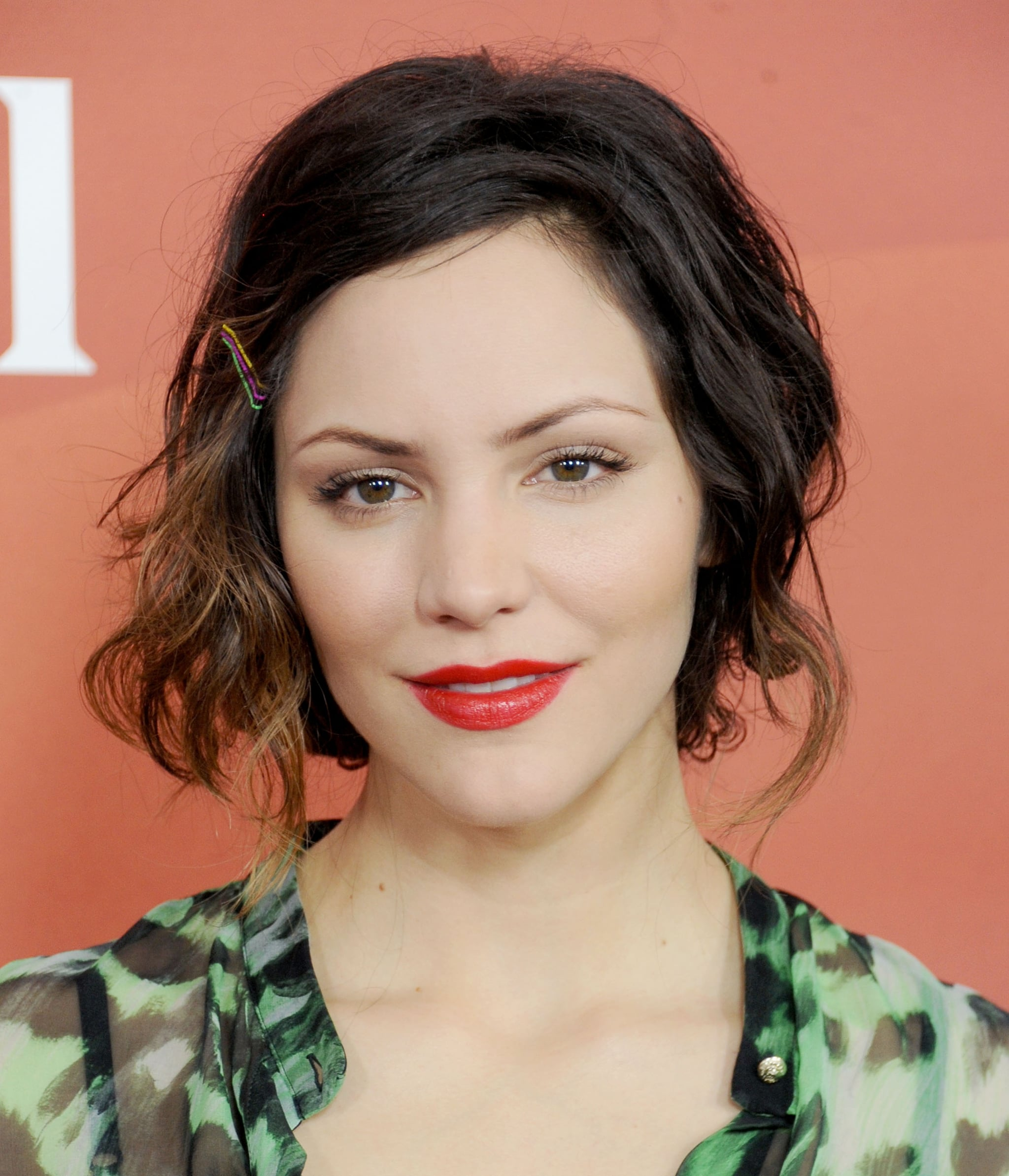 Katharine McPhee's trio of bright bobbies added an element of fun to her style, all while complementing her ruby red lip hue.