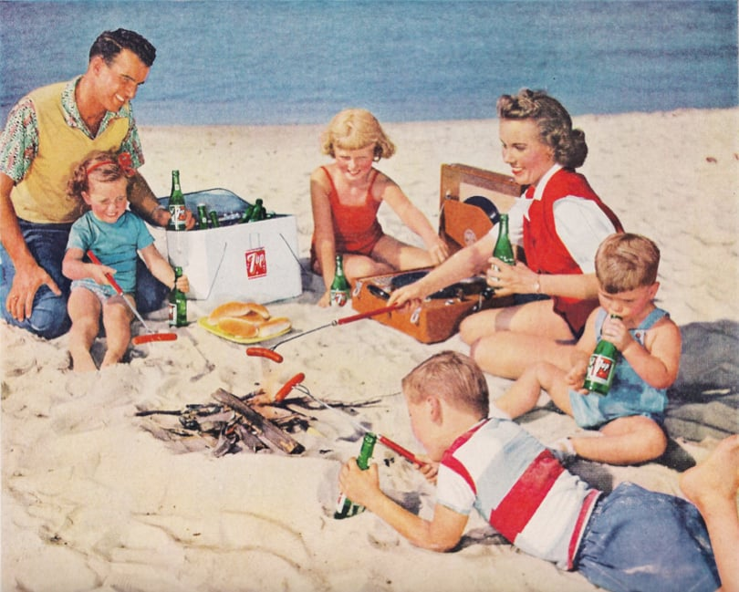 Just an all-American family enjoying dogs on the beach.