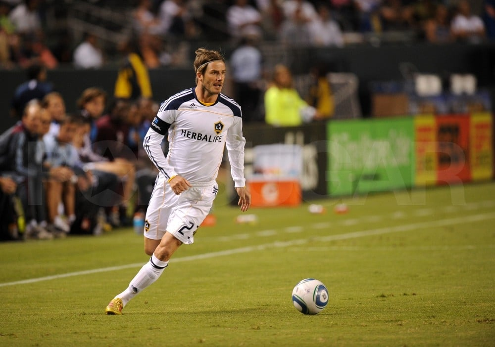 David Beckham looked to pass the soccer ball.