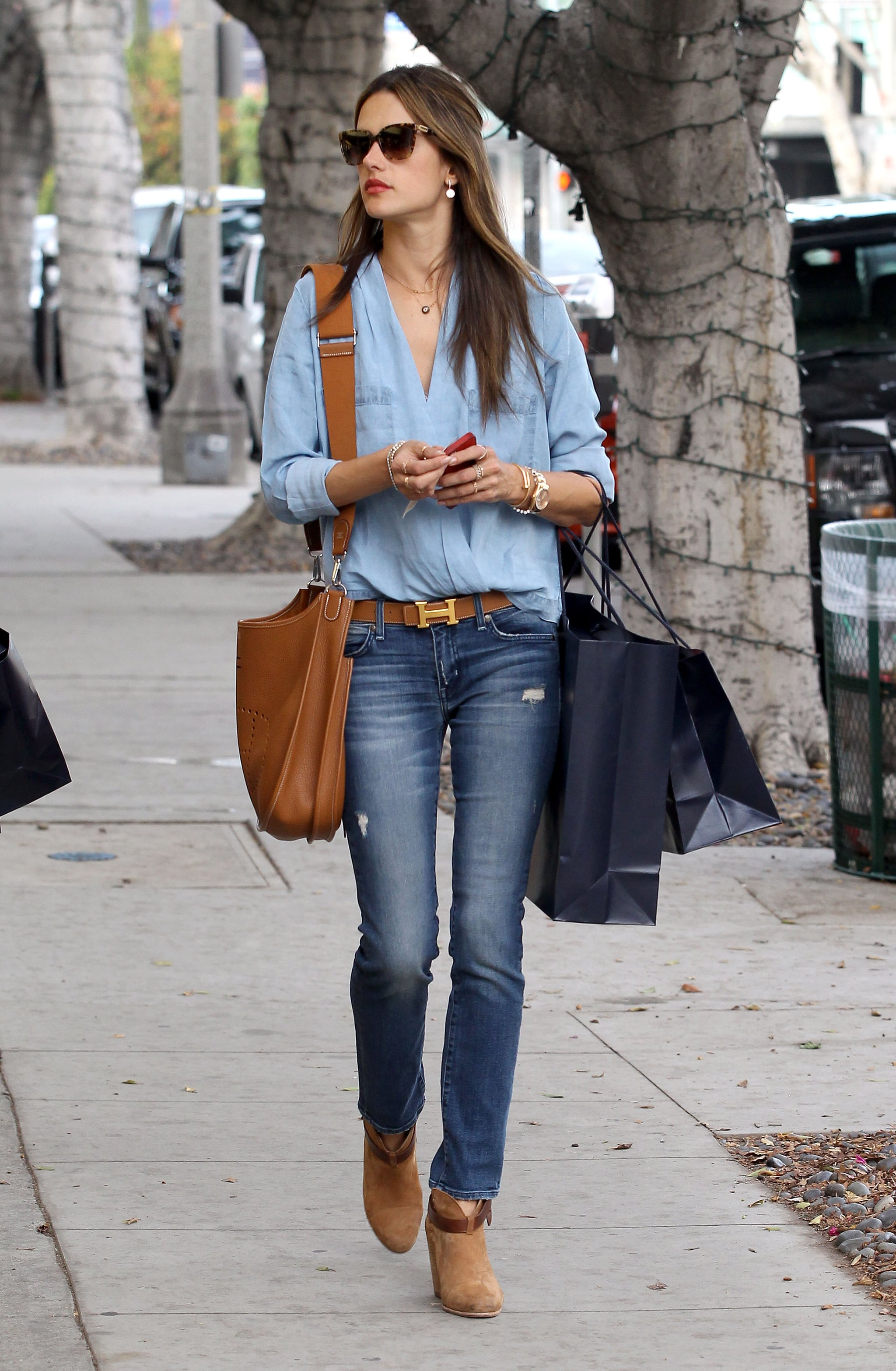 Denim on denim is nothing for the model, who paired a light chambray shirt with skinny jeans. For shoes, she picked low Rag & Bone booties.