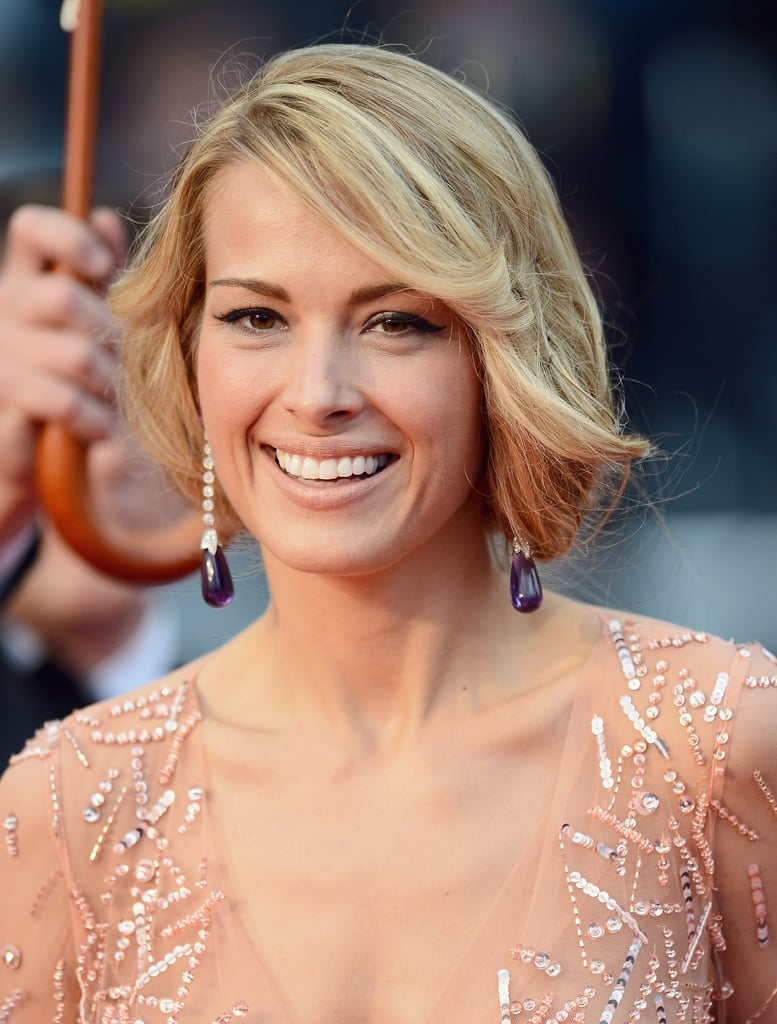 Petra Nemcova wore purple Chopard drop earrings.