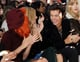 Harry Styles cracked up with Sienna Miller during the Burberry Prorsum show at London Fashion Week.