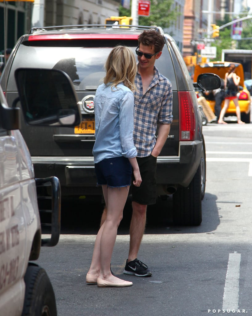 Andrew Garfield smiled at Emma Stone while they stood together.