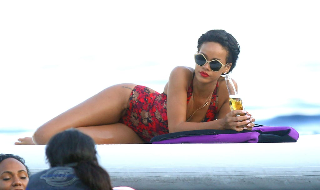 Rihanna looked glamorous while enjoying a beer in the Mediterranean Sea in July 2012.