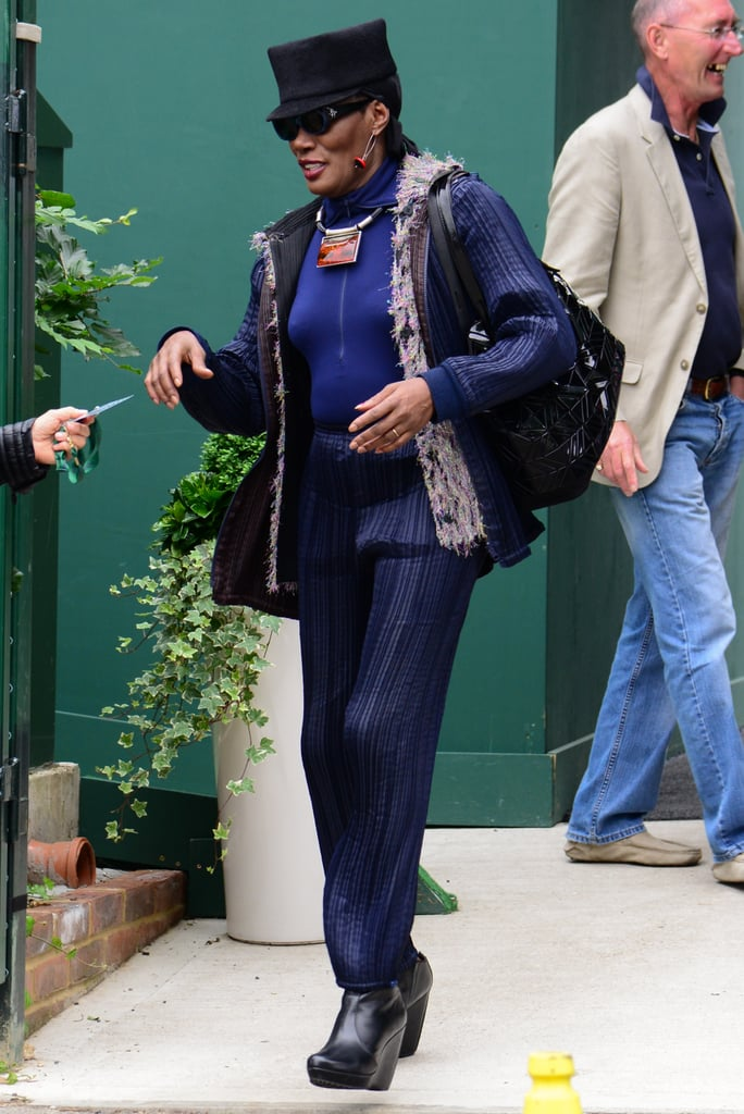 Fashion icons do love a good spectator sport! Grace Jones showed up for a Wimbledon set in shades of blue and a flat-topped hat.