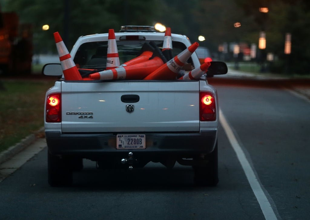 A government truck carried away cones after the government was reopened for business.