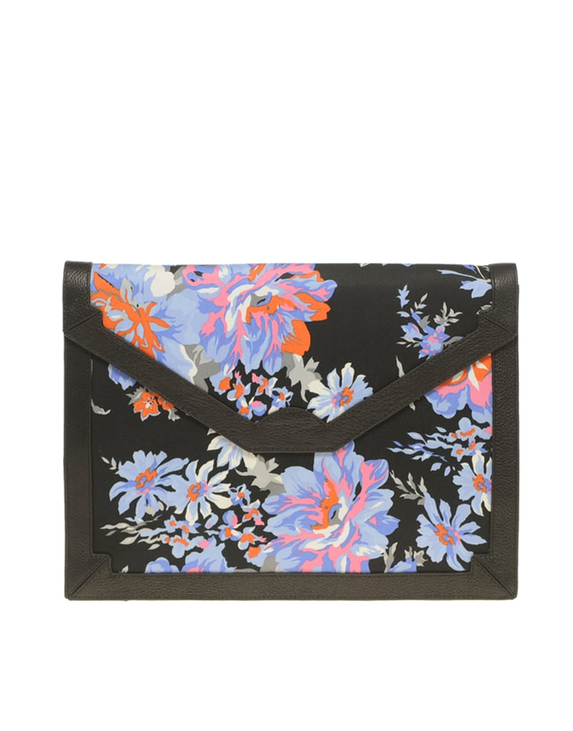 This bold floral clutch would look amazing against a monochrome ensemble.  ASOS Fabric Envelope Clutch With Leather Trim ($81)