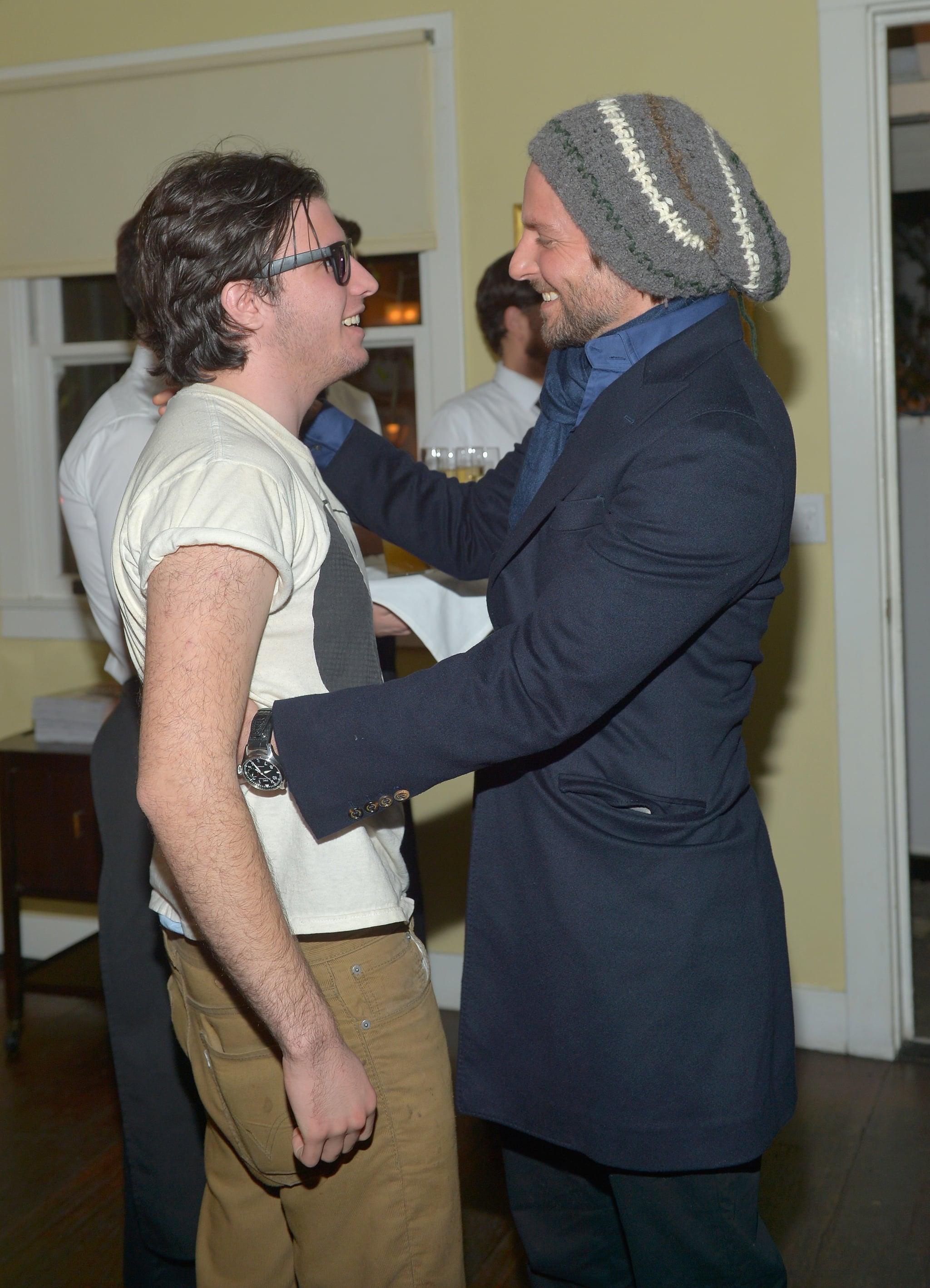 Bradley Cooper linked up with his director David O. Russell's son at a Vanity Fair bash for Silver Linings Playbook in LA on Wednesday night.