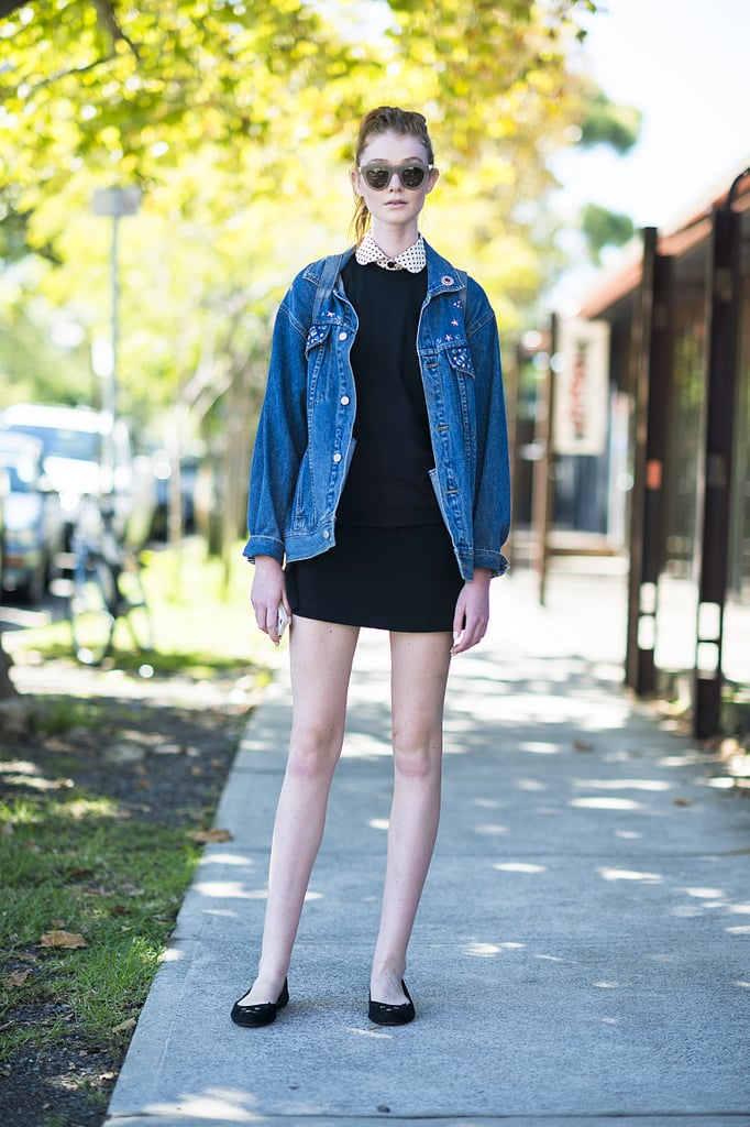This showgoer gave her LBD a tomboy touch with an oversize denim jacket. Source: Le 21ème | Adam Katz Sinding