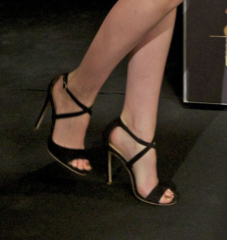 A zoomed-in look at her sleek, streamlined Jerome Rousseau heels.