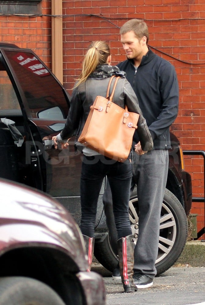 Tom Brady helped Gisele into his car.