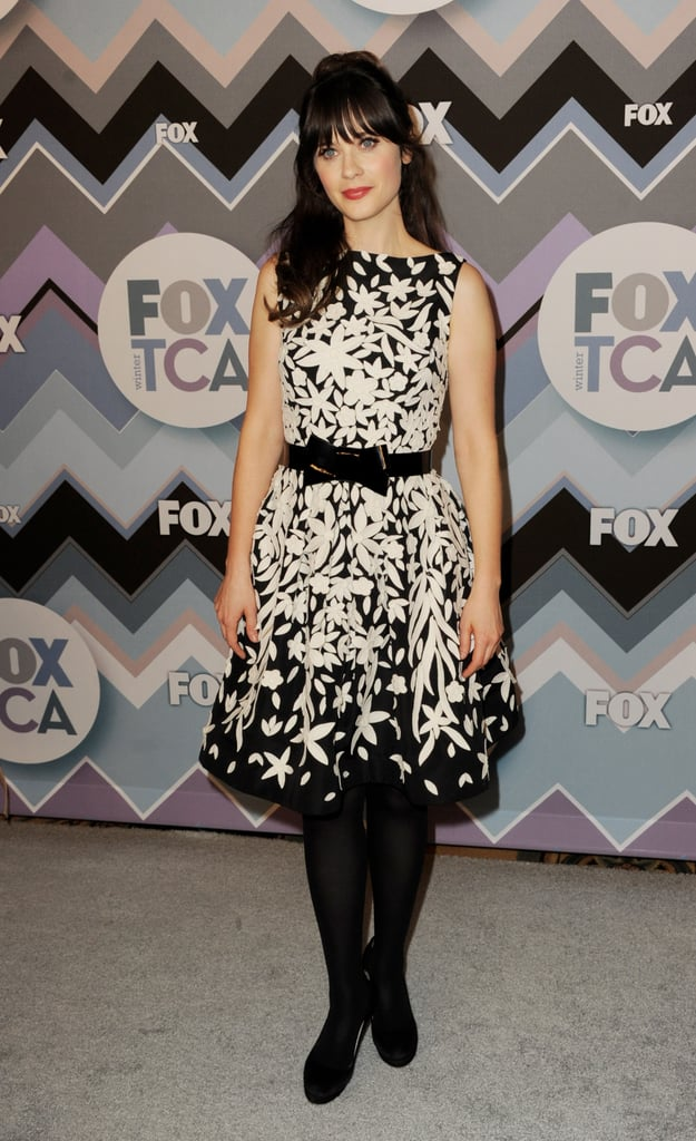 For Fox's All-Star Party, Zooey chose a black-and-white printed Naeem Khan number, which she then paired with a sweet bow-tie belt, black tights, and black pumps.