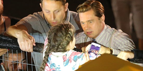 Brad Pitt Helps Save Young Girl From Being Crushed By Mob Of Fans