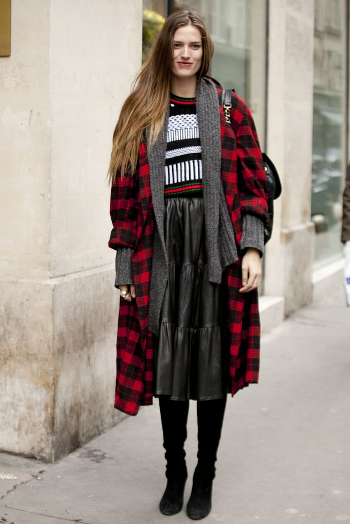 An unexpected play on punk with plaid and a leather midi-skirt.