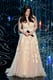 """Despite an improper introduction by John Travolta, Idina Menzel took the stage for an amazing rendition of """"Let It Go."""""""