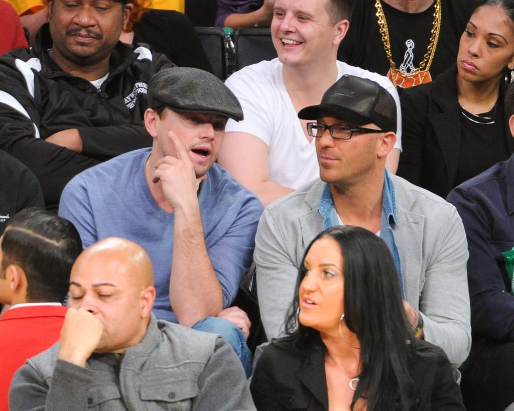 Leonardo DiCaprio chatted courtside Thursday night at the Laker-Miami game.