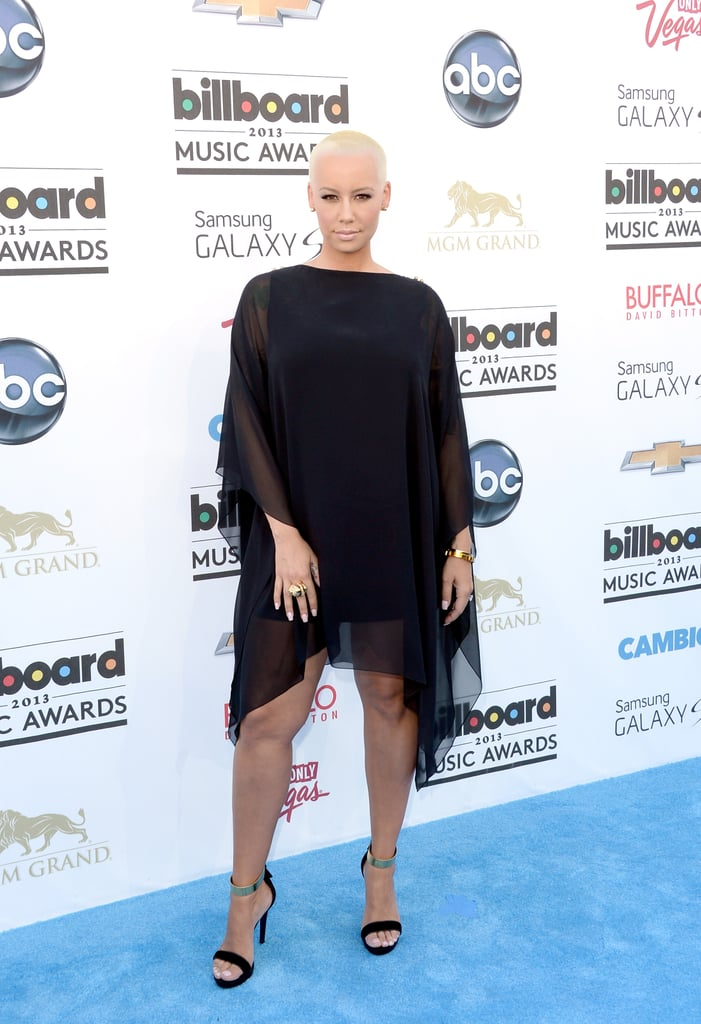 Amber Rose kept it simple in a sheer-sleeved black shift and sandals.
