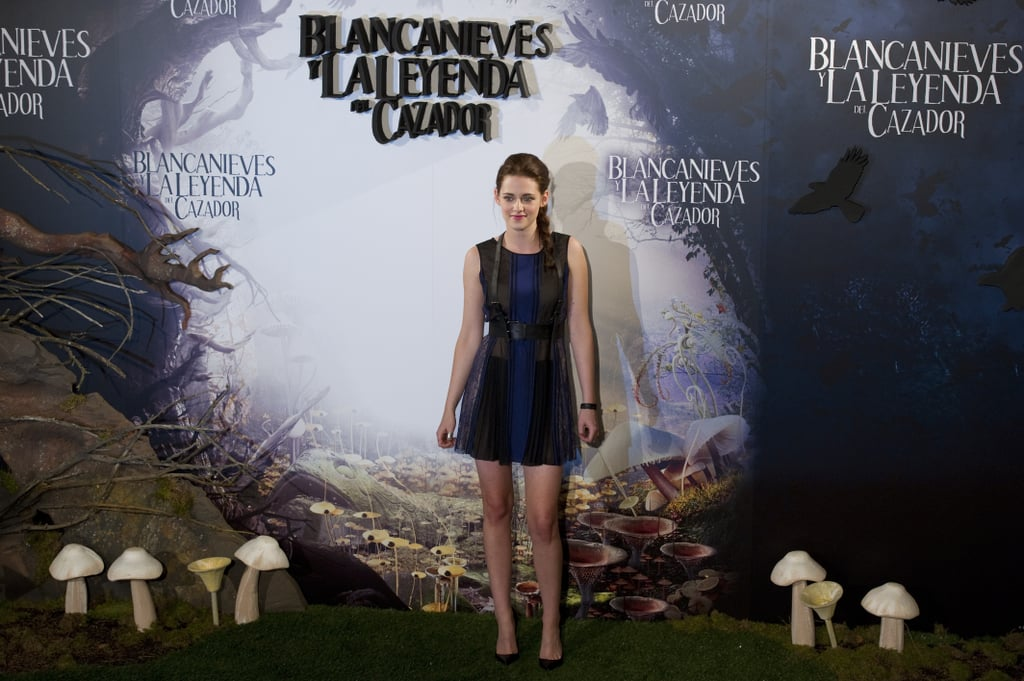 Kristen Stewart wore a black and navy BCBG Max Azria dress for the Snow White and the Huntsman photocall in Madrid.