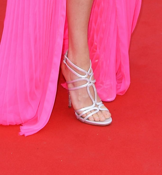Jessica Hart paired metallic strappy heels with her hot-pink gown.