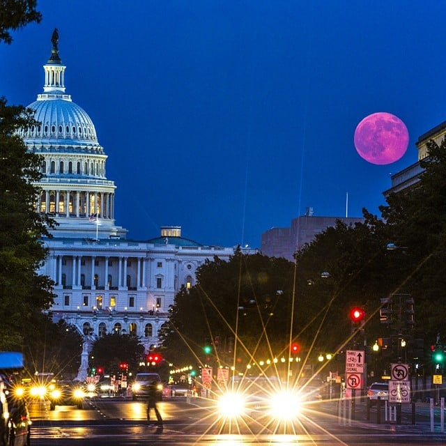 """From National Geographic's Instagram on July 12: """"A view of down Pennsylvania Ave as the super moon rises over the United States Capitol building."""" Source: Instagram user NatGeo"""