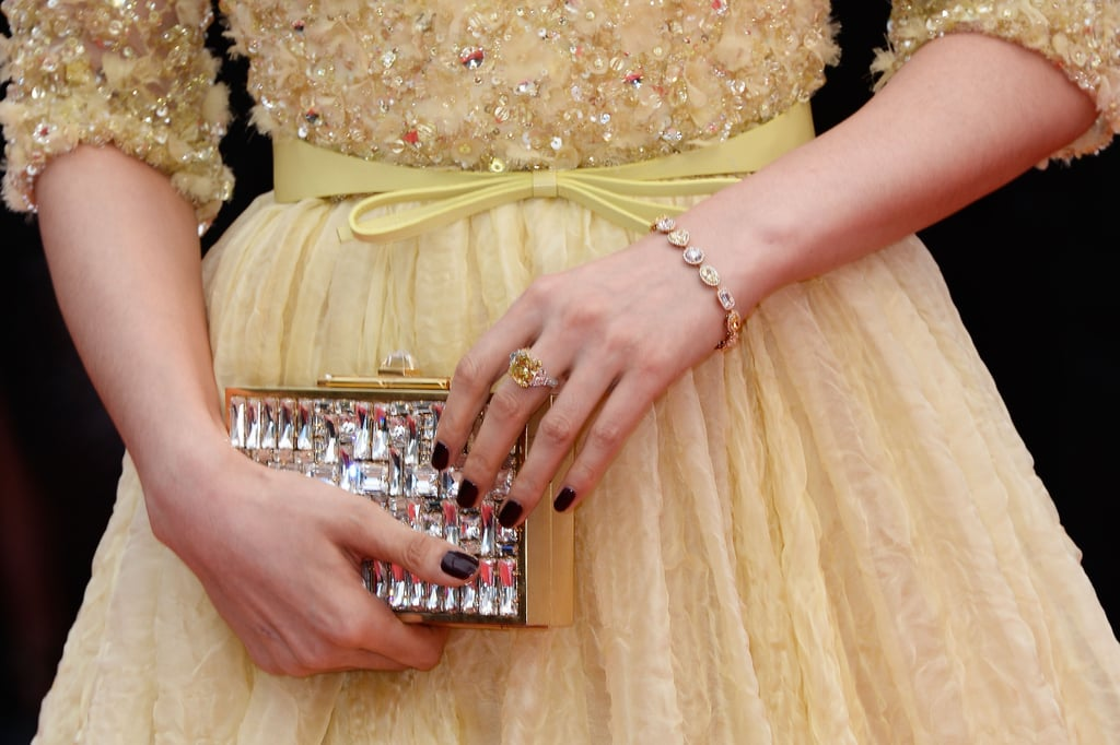 Fan Bingbing carried a crystallized gold clutch and wore yellow diamond jewels by Chopard.