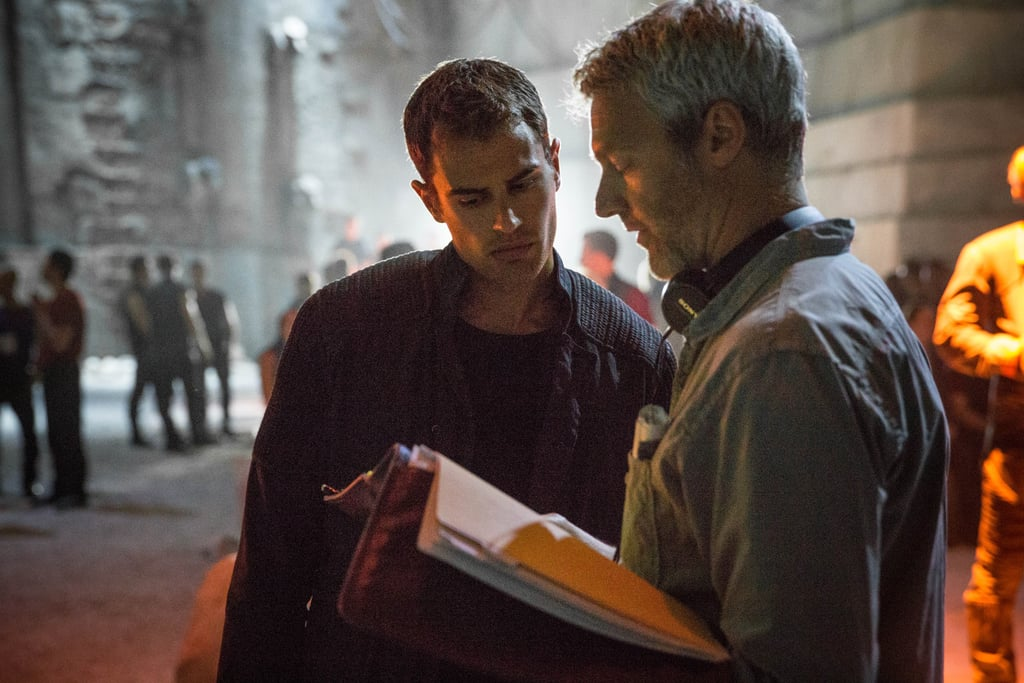 Burger confers with Theo James.
