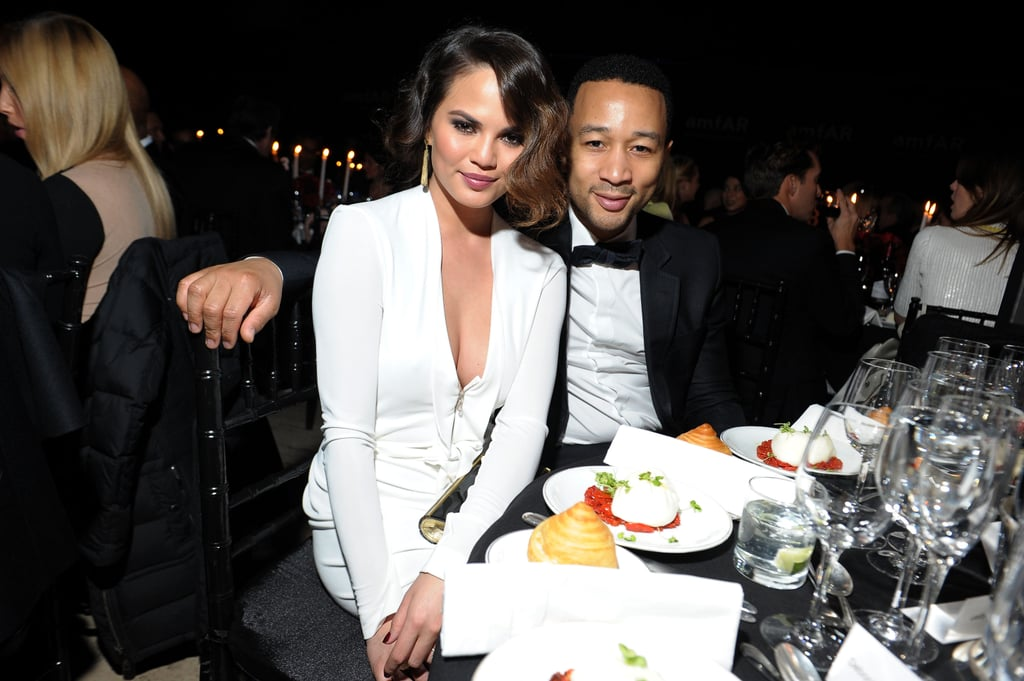 John Legend and Chrissy Teigen cuddled up during the amfAR New York Gala in February.