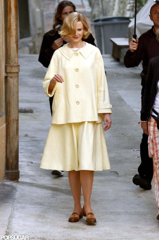Nicole Kidman was dressed as Grace Kelly in a yellow jacket and skirt for her new film, Grace of Monaco.