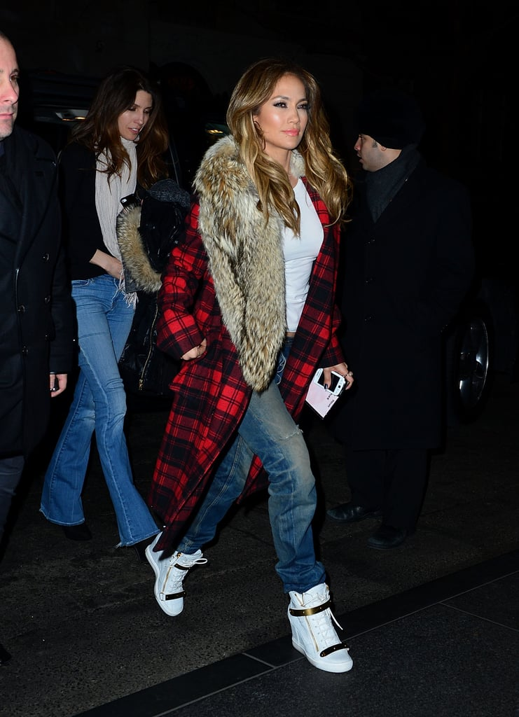 For a sporty vibe, Jennifer paired two unlikely pieces: a plaid fur-trim Michael Kors coat with Giuseppe Zanotti wedge sneakers. Thanks to this ensemble, we now love the idea of Buffalo plaids with baggy jeans, a basic white tee, and and crisp white sneakers, especially for the weekend.