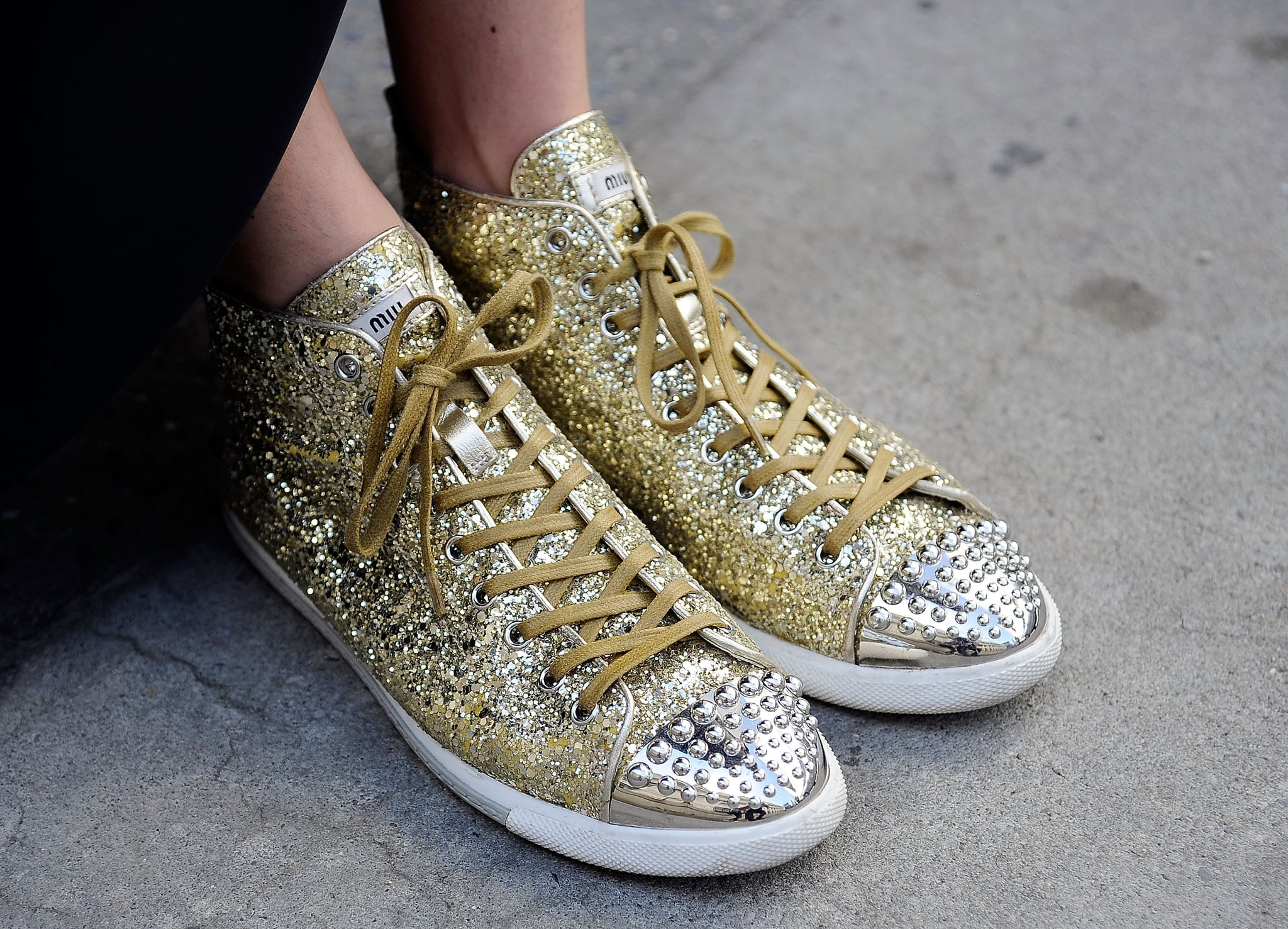 Happy feet, thanks to a pair of studded and sparkly Miu Miu kicks.