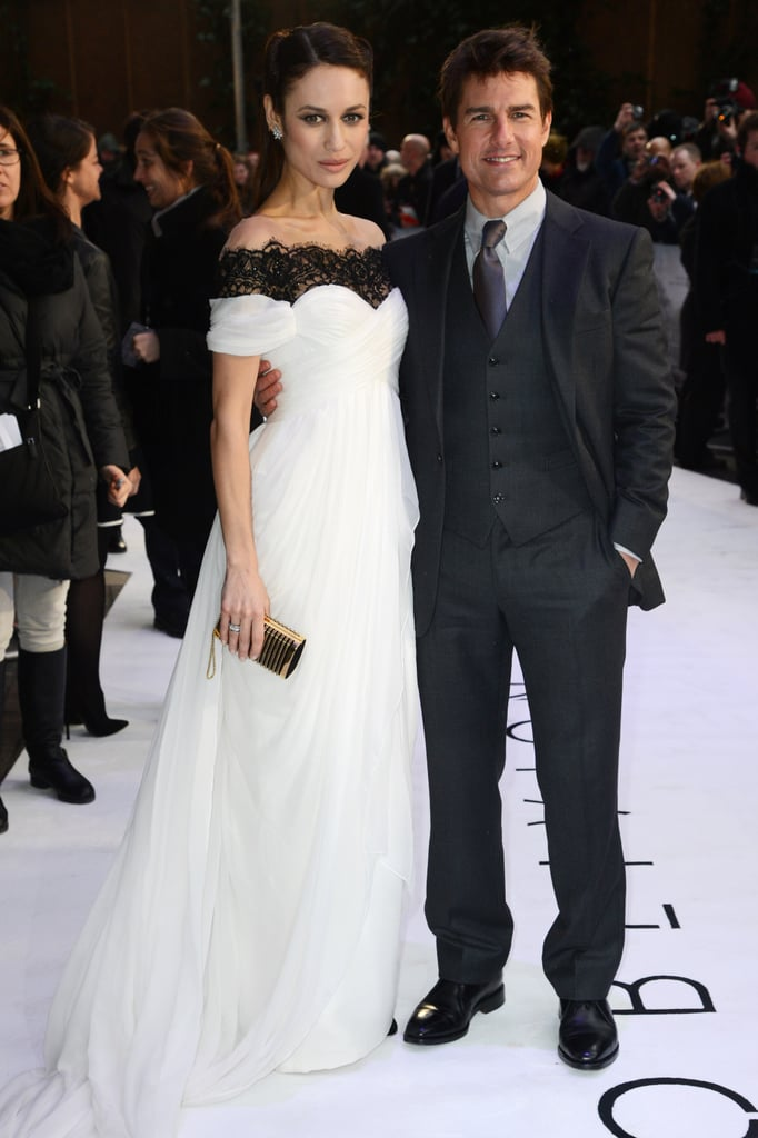 At the London premiere, Olga posed with costar Tom Cruise in a jaw-dropping black-and-white off-the-shoulder gown. She added diamond cluster earrings and a gold studded clutch for a hint of shine.