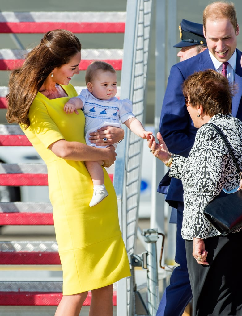 Kate Middleton held Prince George in her arms after the royals landed in Australia on Wednesday.