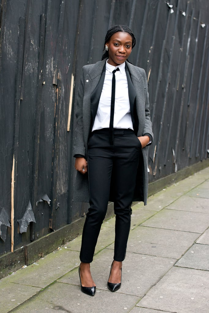 Menswear with a woman's touch via pointed-toe pumps and skinny black trousers.