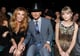 Faith Hill and Tim McGraw sat next to Taylor Swift.