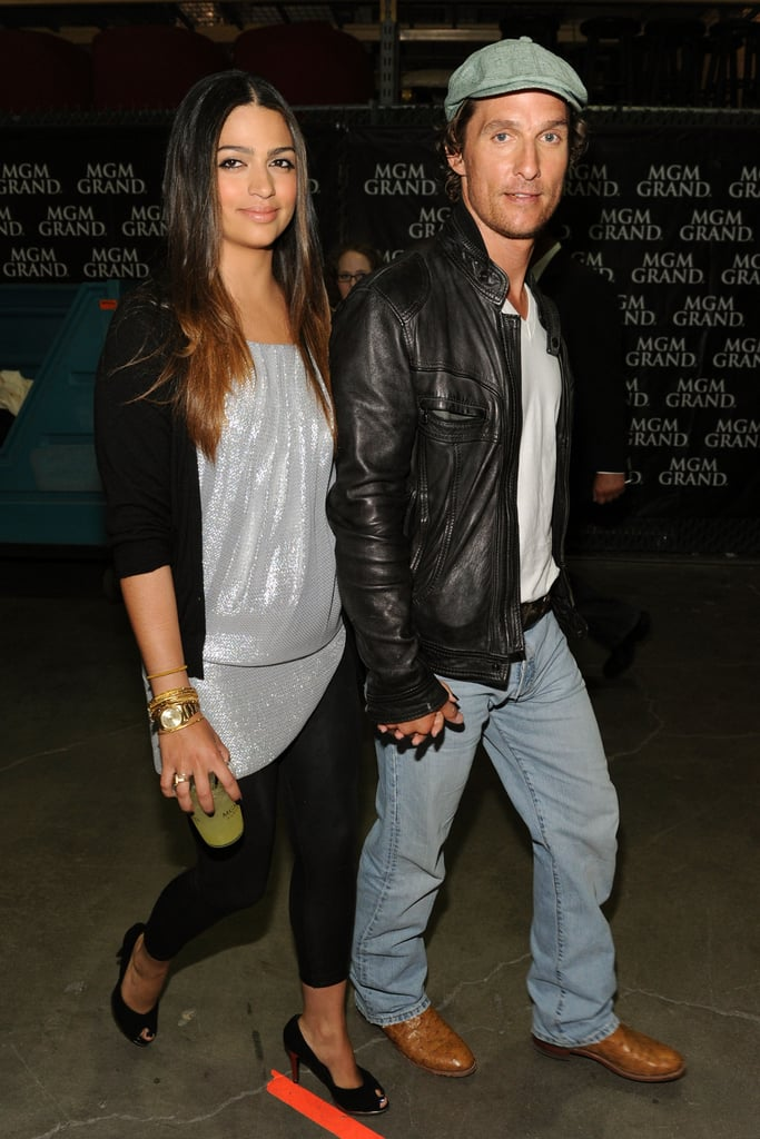 Camila Alves and Matthew McConaughey held hands backstage during a Las Vegas concert in April 2010.