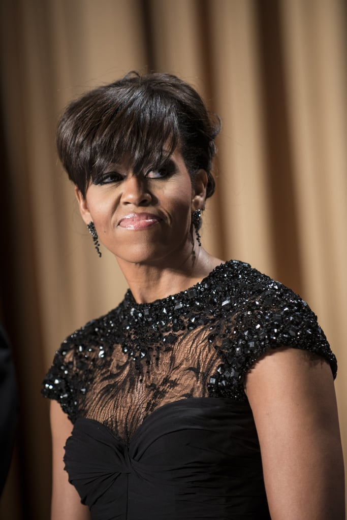 For the 2013 White House Correspondents' Association Dinner, Michelle Obama chose a black beaded, draped chiffon gown by designer Monique Lhuillier.