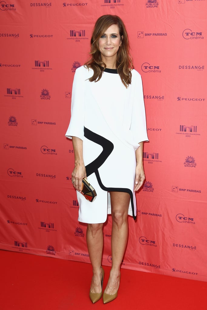 Kristen Wiig proved she's as stylish as she is witty in an asymmetrical black-and-white Prabal Gurung dress and Pierre Hardy heels at the Paris premiere of Imogene.
