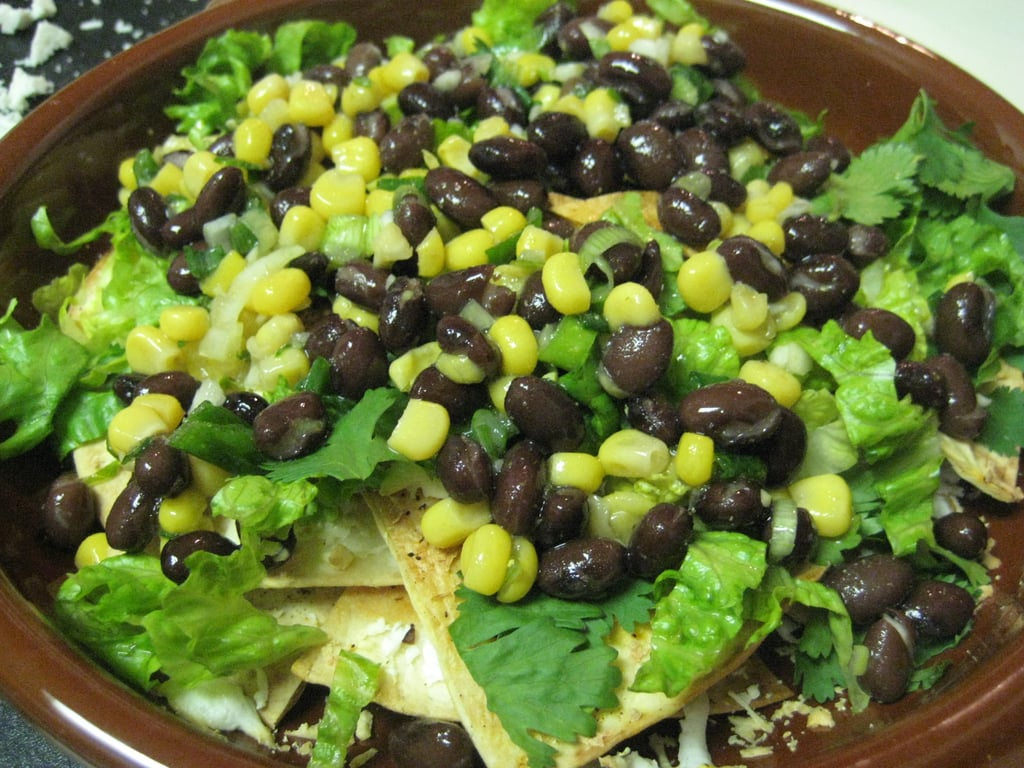 Covering with black bean and corn salad.